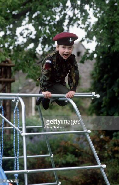 Prince William On His Climbing Frame In The Gardens Of His Home At Highgrove House Wearing A Uniform Of The Parachute Regiment For Which His Father...