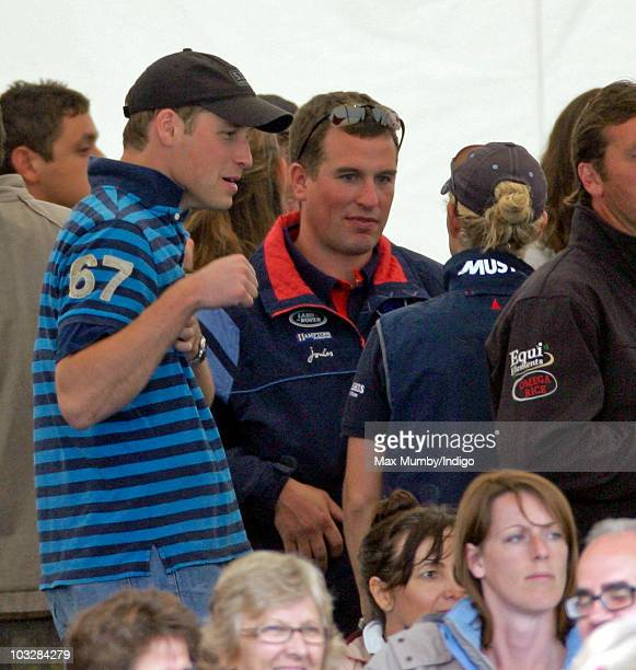 Prince William Peter Phillips and Zara Phillips playfight as they attend day 2 of the Festival of British Eventing at Gatcombe Park on August 7 2010...