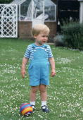 Prince William Playing With A Ball In The Gardens Of His Home Kensington Palace During A Photocall Just Before His Second Birthday