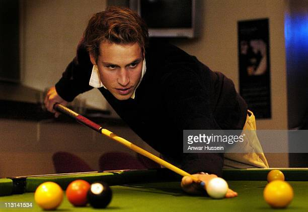 Prince William plays pool at St Andrew's University on November 20 2004 in St Andrews Scotland