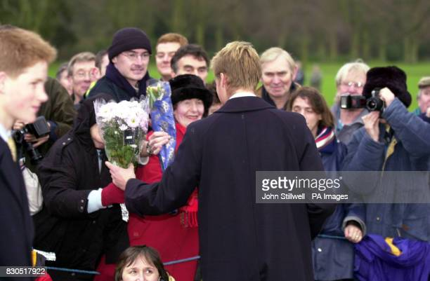 Prince William receives flowers from wellwishers after he and the rest of the Royal Family attended a Sunday church service St Mary Magdalene Church...