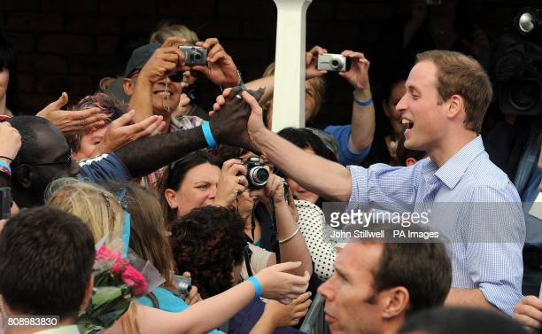 Prince William shakes hands with crowds as he leaves the Toowoomba Showgrounds where a concert took place for the town near Brisbane Australia which...