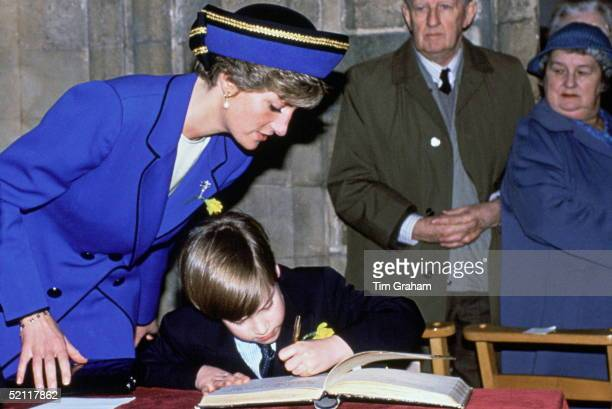Prince William Signing His Name Whilst His Mother Princess Diana Watches They Are On A Visit To Wales To Mark Saint David's Day