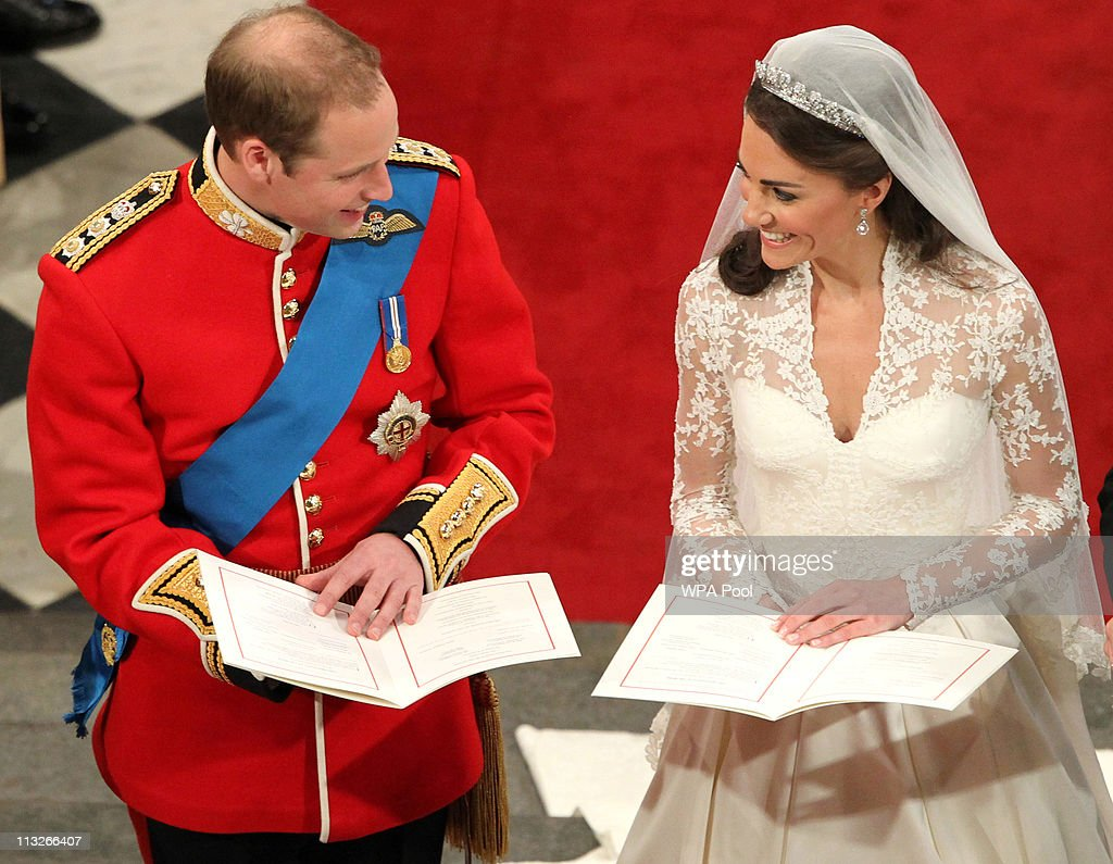 Prince William sings beside his bride Catherine Middleton during their wedding at Westminster Abbey on April 29 2011 in London England The marriage...