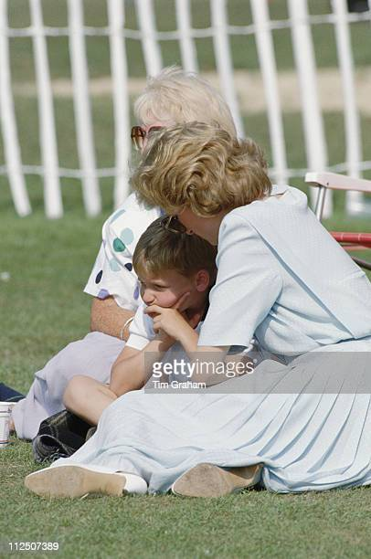 Prince William sitting with his mother Diana Princess of Wales at the Cartier International Polo Day held at Smiths Lawn Polo Club in Windsor...