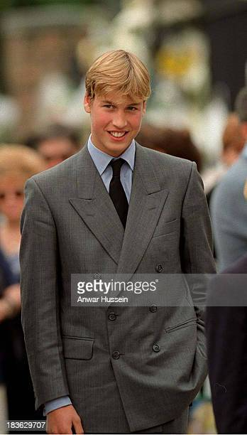 Prince William smiles as he arrives to view floral tributes to his mother Princess Diana outside Kensington Palace on September 05 1997 in London...
