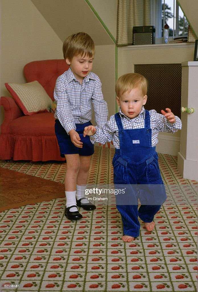 Prince William Standing Behind His Brother, <a gi-track='captionPersonalityLinkClicked' href=/galleries/search?phrase=Prince+Harry&family=editorial&specificpeople=178173 ng-click='$event.stopPropagation()'>Prince Harry</a>, To Help Him As He Tries To Walk On His Own In The Playroom At Kensington Palace