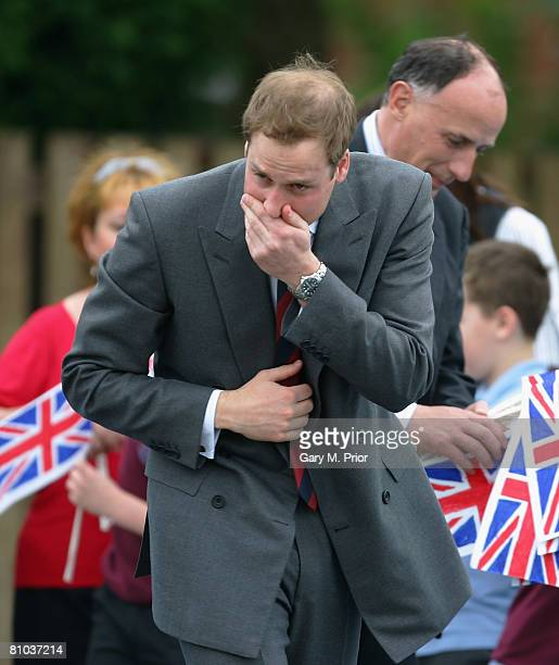 Prince William stifles a sneeze during a visit to St Aidan's Primary School on May 9 2008 in Blackburn England