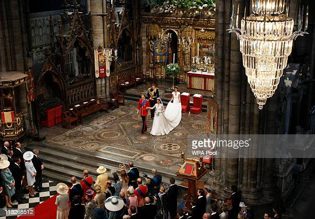 Prince William takes the hand of his bride Catherine Middleton now to be known as Catherine Duchess of Cambridge as they walk down the aisle followed...