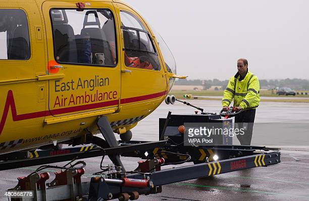 Prince William The Duke of Cambridge prepares his helicopter as he begins his new job with the East Anglian Air Ambulance at Cambridge Airport on...