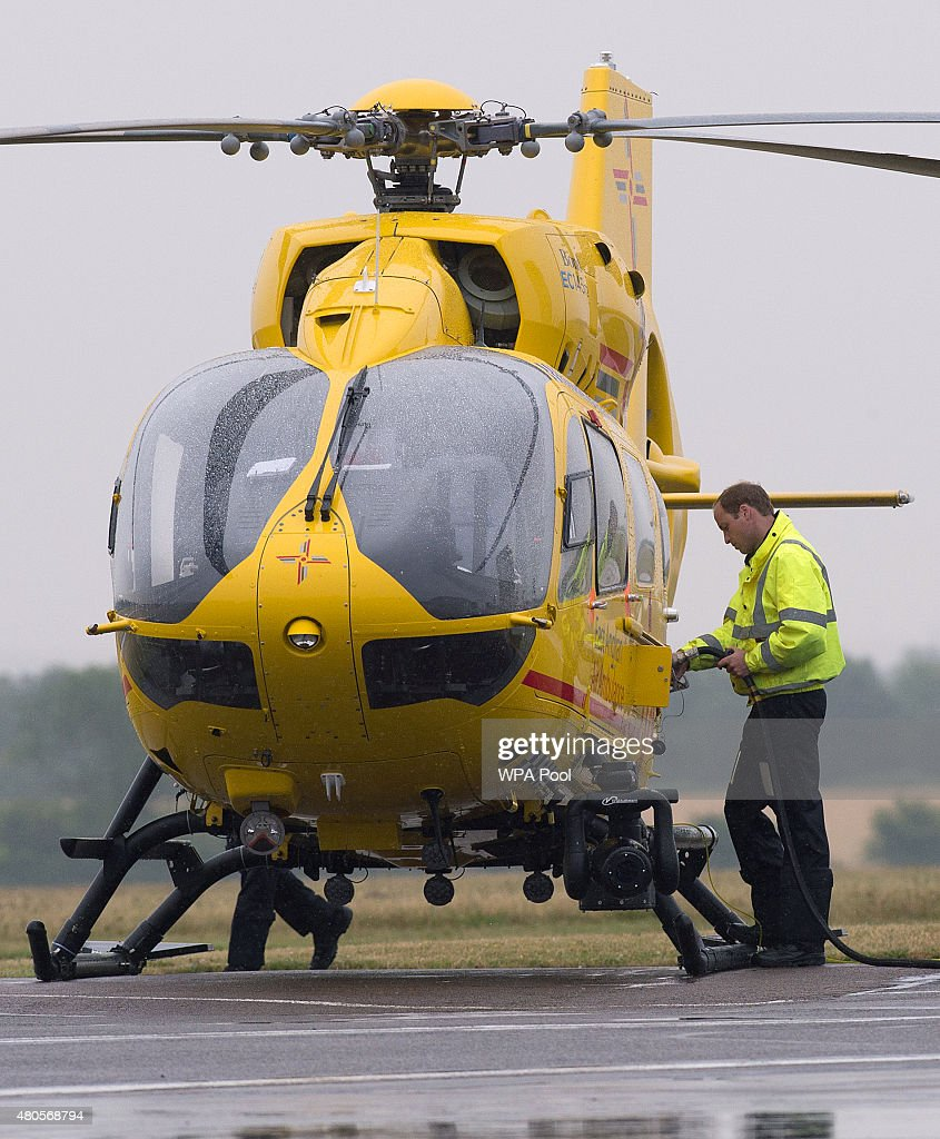 Prince William, The Duke of Cambridge refuels his helicopter as he begins his new job with the East Anglian Air Ambulance (EAAA) at Cambridge Airport on July 13, 2015 in Cambridge, England. The former RAF search and rescue helicopter pilot will work as a co-pilot transporting patients to hospital from emergencies ranging from road accidents to heart attacks.