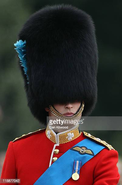 Prince William the Duke of Cambridge rides to Buckingham Palace after taking part in the Trooping the Colour parade on June 11 2011 in London England...