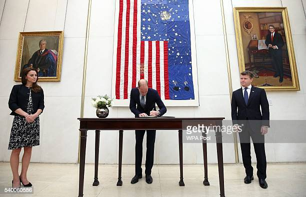 Prince WIlliam The Duke of Cambridge signs a book of condolence for the Orlando mass shooting victims while Catherine Duchess of Cambridge and...