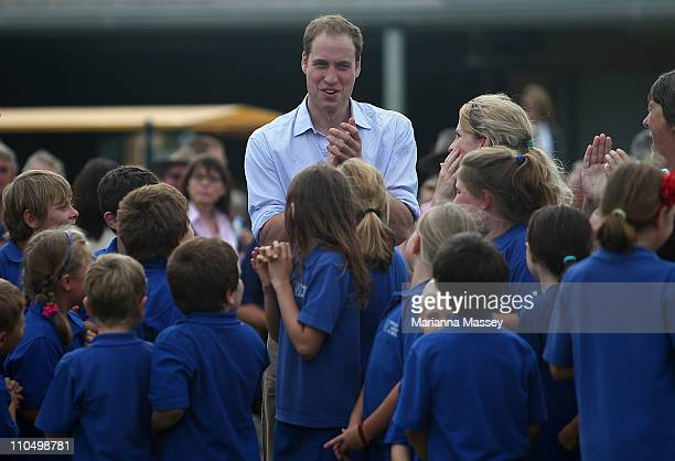Prince William visits with local school children at the Marrabit Recreational grounds on March 21 2011 in Kerang Australia His Royal Highness is in...