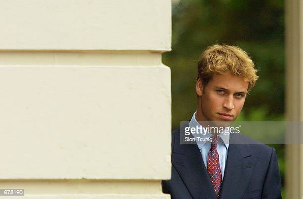 Prince William waits for The Queen Mother during celebrations to mark her 101st birthday August 4 2001 in London