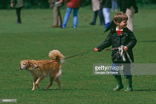 Prince William walking a dog at a polo match in Cirencester UK 6th June 1987