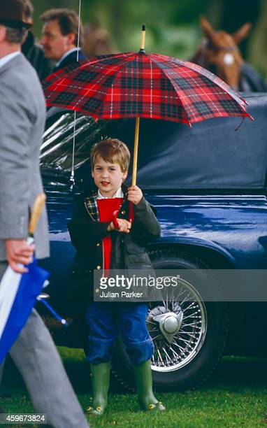 Prince William watches Prince Charles play Polo at Cirencester Polo Club on June 6 1987 in Windsor United Kingdom