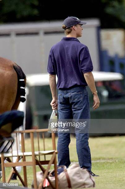 Prince William Watching His Father And Brother Play On The Same Team He Is Holding A Bottle Of Mineral Water