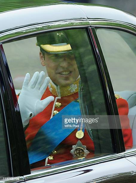 Prince William waves as he travels in a Bentley to Westminster Abbey for his marriage to Catherine Middleton on April 29 2011 in London England The...