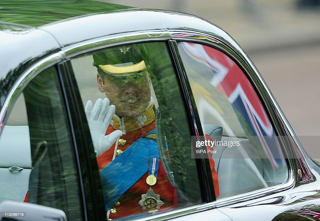 Prince William waves as he travels in a Bentley to Westminster Abbey for his marriage to Catherine Middleton on April 29, 2011 in London, England. The marriage of Prince William, the second in line to the British throne, to Catherine Middleton is to be led by the Archbishop of Canterbury and will be attended by 1900 guests, including foreign Royal family members and heads of state. Thousands of well-wishers from around the world have also flocked to London to witness the spectacle and pageantry of the Royal Wedding.