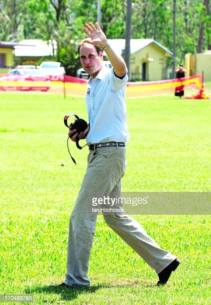Prince William waves to the crowd before flying out of Cardwell on a Blackhawk helicopter on March 19 2011 in Cardwell Australia His Royal Highness...