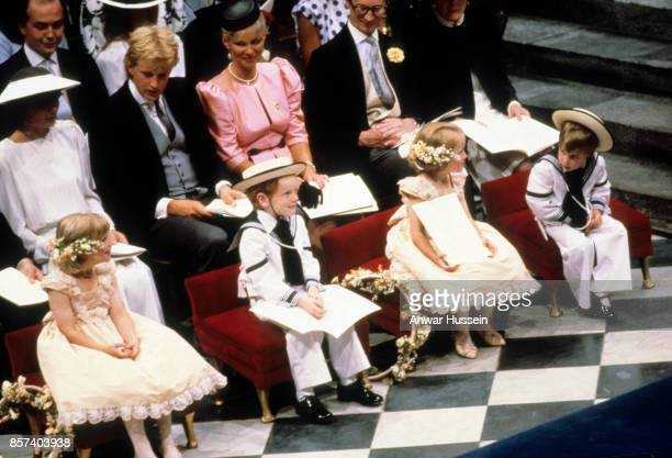 Prince William wearing a sailorsuit acts as a pageboy at the wedding of Prince Andrew Duke of York and Sarah Ferguson on July 23 1986 in London...