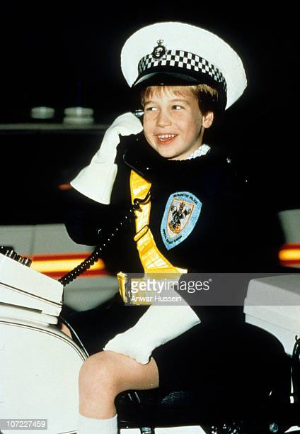 Prince William wears a policeman's uniform as he sits on a police motorbike during a visit to the Windsor police in November 1987 in Windsor England