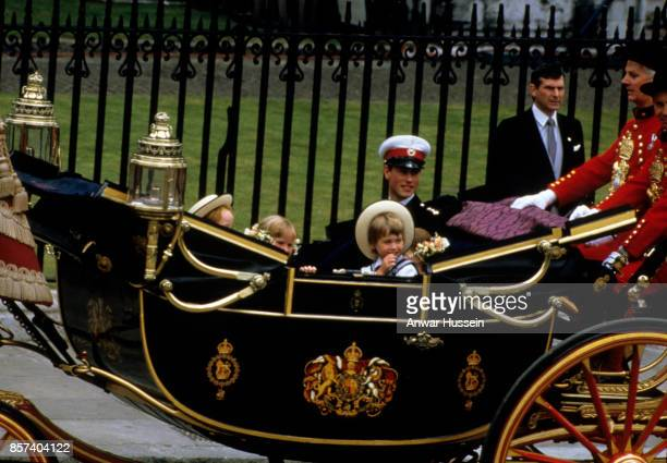 Prince William who acted as a pageboy rides in an open carriage with Prince Edward following the wedding of Prince Andrew Duke of York and Sarah...