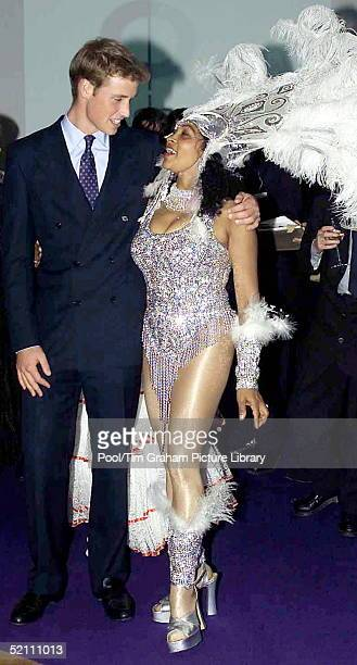 Prince William With His Arm Around An Exotically Dressed Dancer Gazing Into Her Yes During His Visit To Dancebase In Edinburgh Scotland