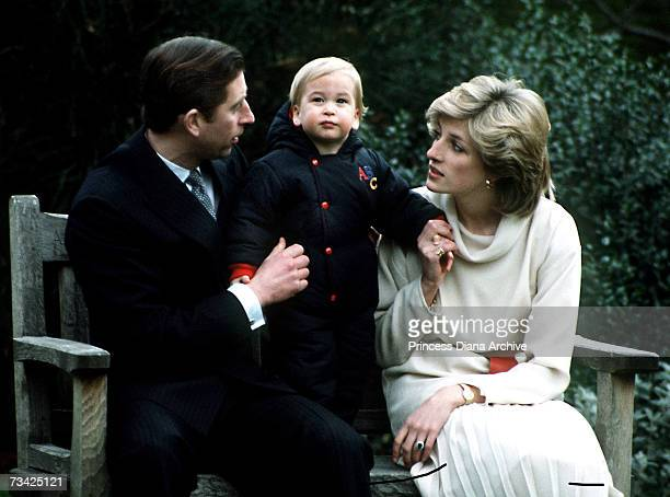 Prince William with his parents Prince Charles and Princess Diana at his first official photocall in the garden at Kensington Palace London 14th...