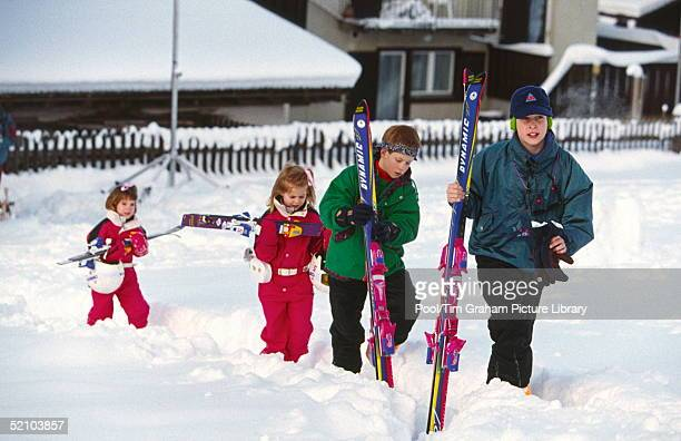 Prince William With Prince Harry And Their Cousins Princess Beatrice And Princess Eugenie Walking Up The Slope For A Photocall During Their Skiing...