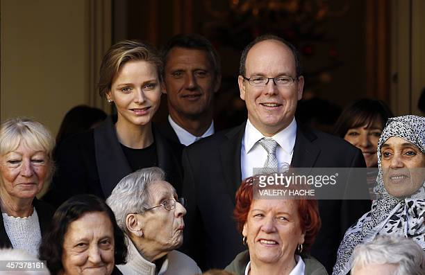 Prince's Albert II and Princess Charlene of Monaco pose after they gave Christmas presents to residents of Monaco on December 17 in Monaco AFP PHOTO...