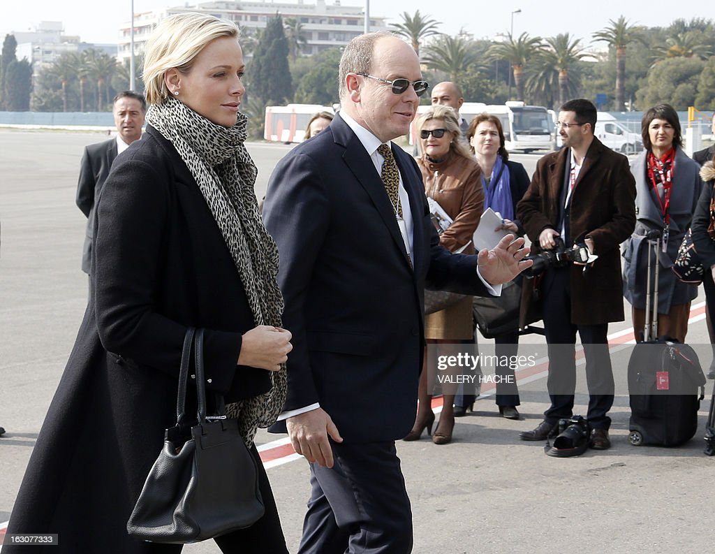 Prince's Albert II of Monaco (R) and his wife Princess Charlene arrive on March 4, 2013 to attend the presentation of the Monegasque Princely family's new 'Falcon 7X' plane and its hangar in Nice airport, southeastern France.
