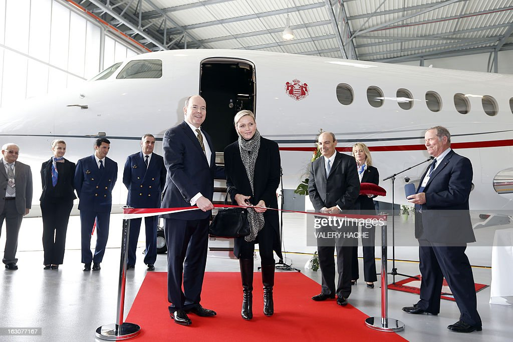 Prince's Albert II of Monaco and his wife Princess Charlene attend on March 4, 2013 the presentation of the Monegasque Princely family's new 'Falcon 7X' plane and its hangar in Nice airport, southeastern France.