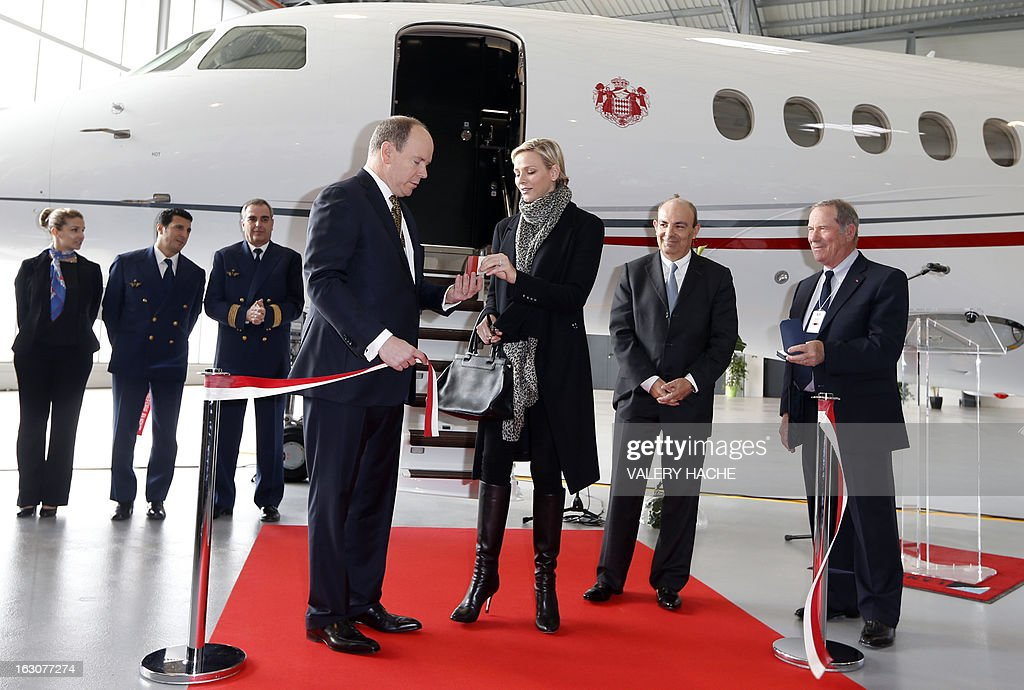 Prince's Albert II (C) of Monaco and his wife Princess Charlene attend on March 4, 2013 the presentation of the Monegasque Princely family's new 'Falcon 7X' plane and its hangar in Nice airport, southeastern France.