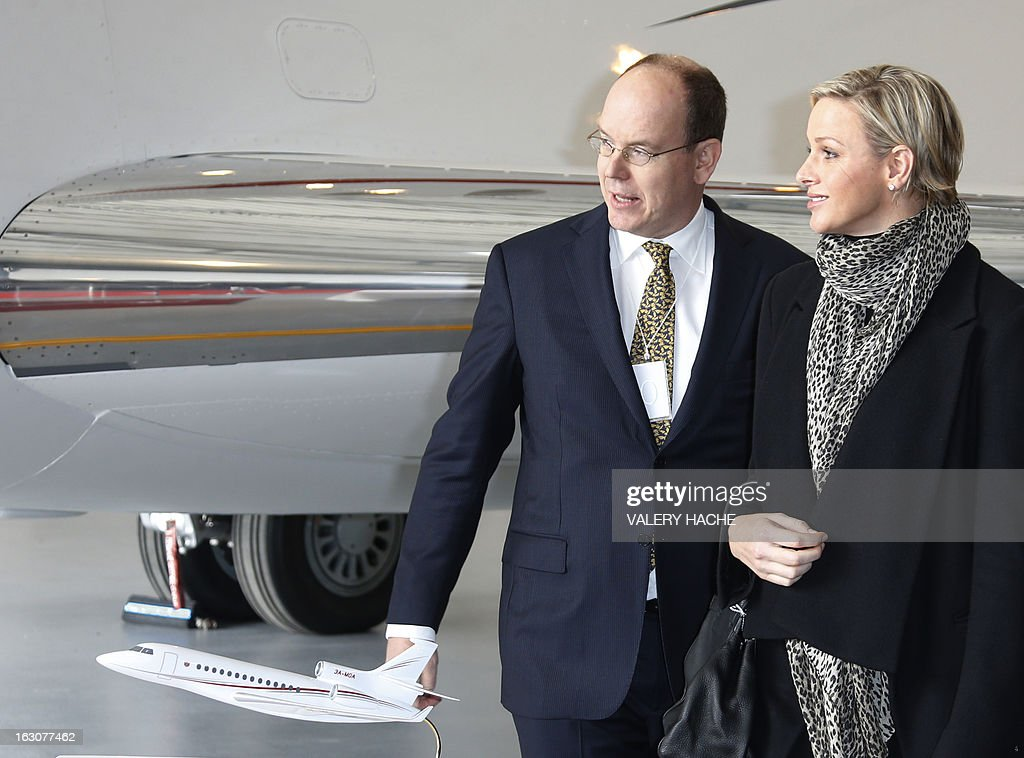 Prince's Albert II of Monaco (L) and his wife Princess Charlene attend on March 4, 2013 the presentation of the Monegasque Princely family's new 'Falcon 7X' plane and its hangar in Nice airport, southeastern France.