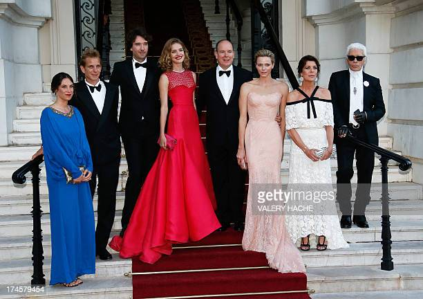 Prince's Albert II of Monaco and his wife Princess Charlene of Monaco pose with Russian model and founder of 'Naked Heart Foundation' Natalia...