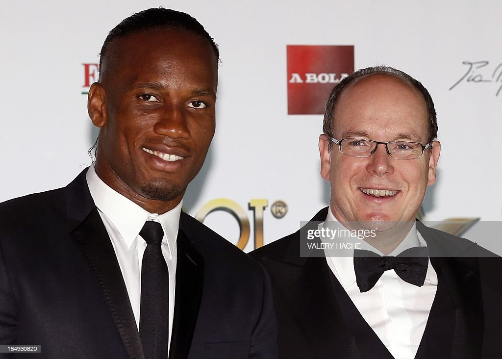 Prince's Albert II of Monaco (R) and Ivorian football player Didier Drogba pose on October 16, 2013 in Monaco for the 2013 Golden Foot Award Gala. The Golden Foot award is an international career award given to players who stand out for their athletic achievements.