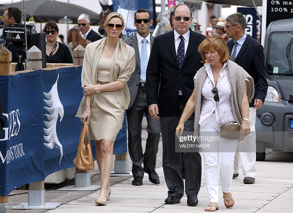 Prince's Albert II of Monaco and Princess Charlene (L) arrive at the 2013 Monaco International Jumping as part of Global Champions Tour on June 28, 2013 in Monaco. AFP PHOTO / VALERY HACHE