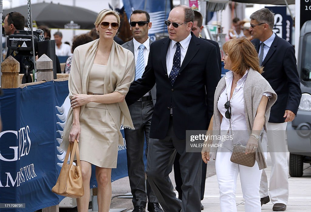 Prince's Albert II of Monaco and Princess Charlene (L) arrive at the 2013 Monaco International Jumping as part of Global Champions Tour on June 28, 2013 in Monaco.