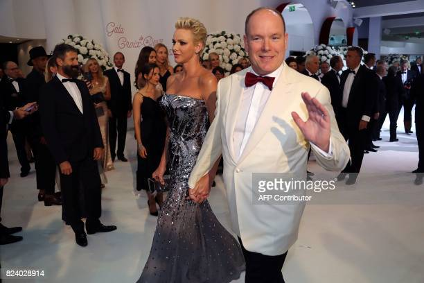 Prince's Albert II of Monaco and Princess Charlene arrive for the Rose Ball at the MonteCarlo Sporting Club in Monaco during the 69th annual Red...