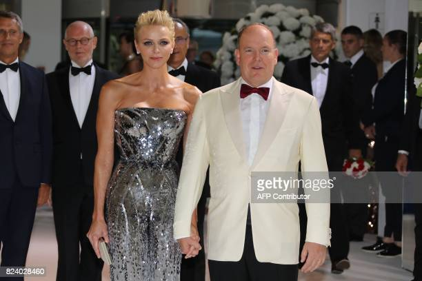 Prince's Albert II of Monaco and Princess Charlene pose during the Rose Ball at the MonteCarlo Sporting Club in Monaco during the 69th annual Red...