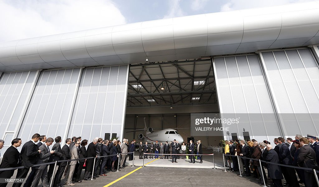Prince's Albert II of Monaco and Princess Charlene (C, R), Princess Caroline of Hanover (C, L) and her son Pierre Casiraghi attend on March 4, 2013 the presentation of the Monegasque Princely family's new 'Falcon 7X' plane and its hangar in Nice airport, southeastern France.