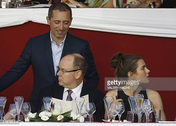 Prince's Albert II of Monaco Charlotte Casiraghi and French humorist and actor Gad Elmaleh attend at the 2015 edition of the Jumping International of...