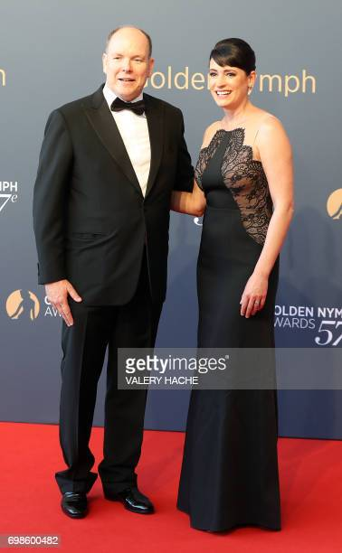 Prince's Albert II of Monaco poses with US actress Paget Brewster during the closing ceremony of the 57th MonteCarlo Television Festival on June 20...