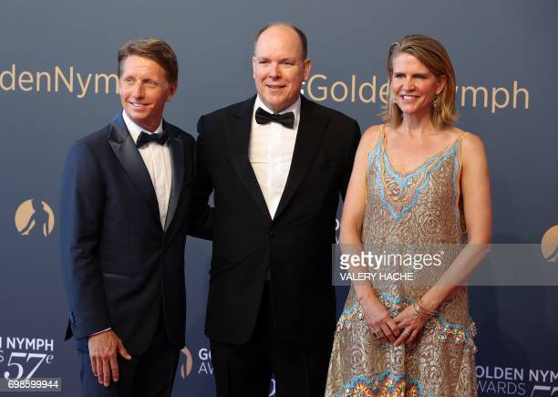 Prince's Albert II of Monaco poses with US executive producer Bradley Bell and his wife Colleen Bell during the closing ceremony of the 57th...