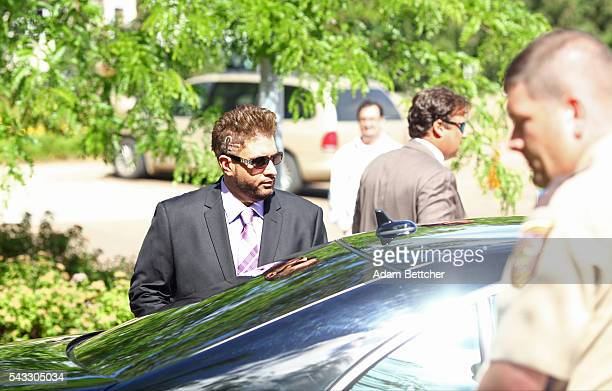 Prince's halfbrother Omarr Baker makes his way out of the Carver County Justice Center on June 27 2016 in Chaska Minnesota Prince died on April 21...