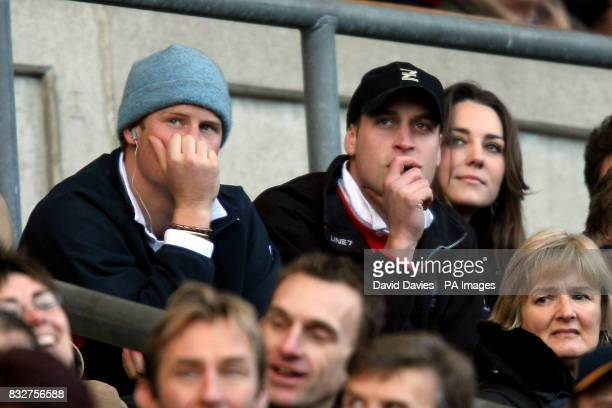 Prince's Harry and William watch the action from the stands with Williams girlfriend Kate Middleton