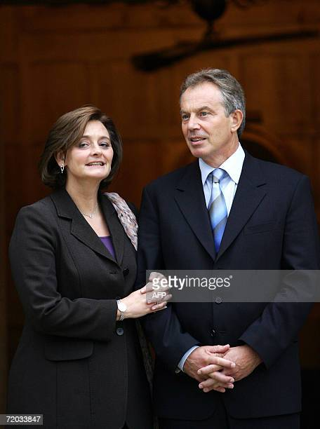 British Prime Minister Tony Blair and his wife Cherie Blair wait for the arrival of Pakistan President Pervez Musharraf and first lady Sahba...