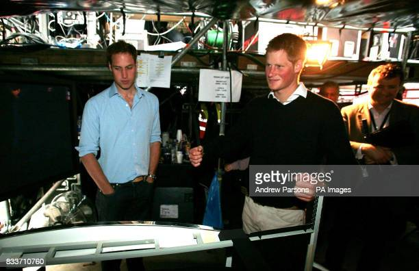Princes William and Harry tour the production sound and lighting section during a visit to the new Wembley Stadium London